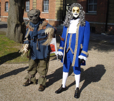 Dalek Invasion of Portsmouth 2013: A scarecrow and a clockwork robot.