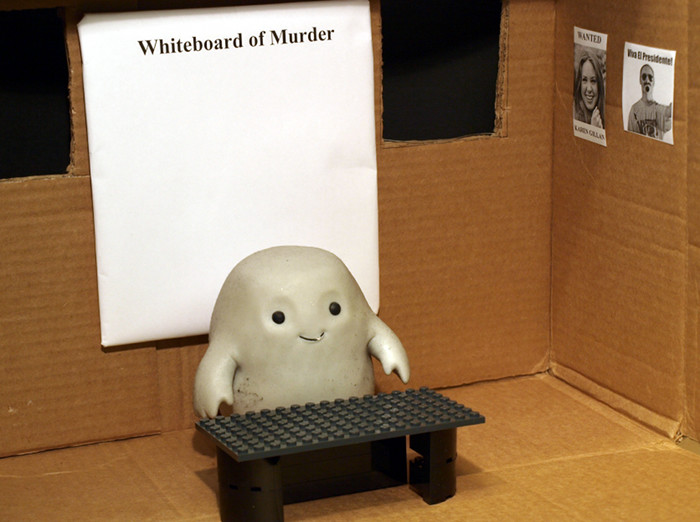 Chief Inspector Grey-um #1 - Grey-um alone in his office.