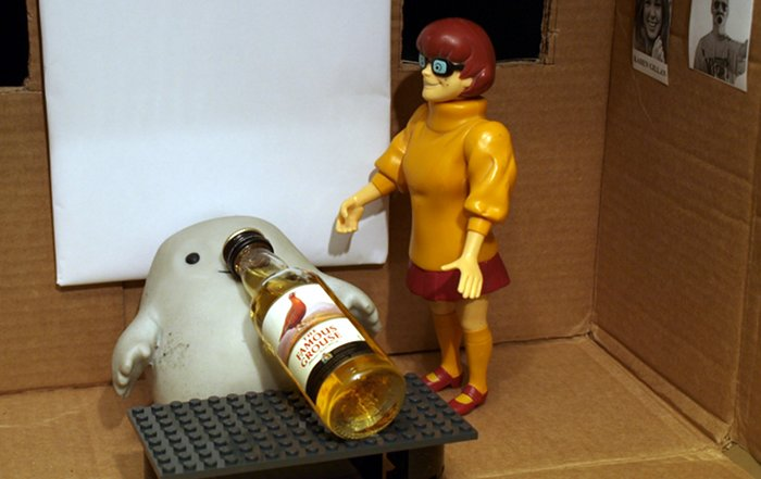 Chief Inspector Grey-um #1 - Grey-um and Dinkley in his office, with a miniature whisky.