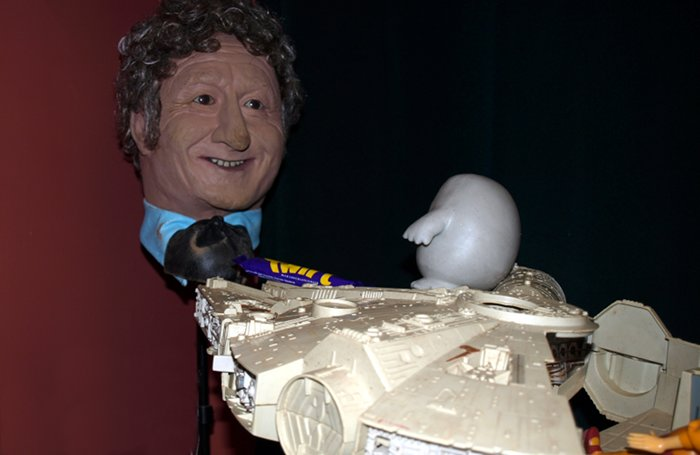 Chief Inspector Grey-um #1 - Grey-um and Dinkley in the Falcon, hovering by The Head of Pertwee, offering him a Twirl.