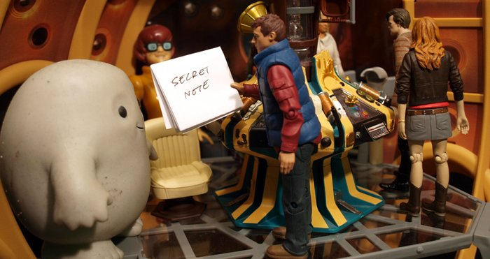 Chief Inspector Grey-um #1 - Close up of Rory giving Grey-um a slip of paper.