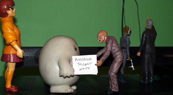 Chief Inspector Grey-um #1 - Close up of Grey-um being given a note by Wilbo the Weevil.