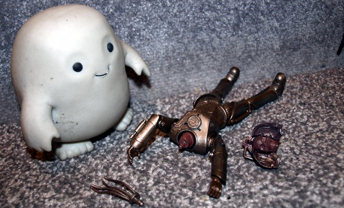 Chief Inspector Grey-um #1 - Grey-um looking at Cyril the cyberman's body.